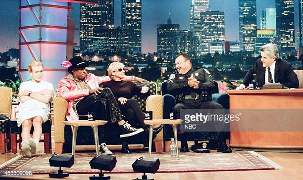 Actor Jack Riley professional basketball player Dennis Rodman comedian Ellen DeGeneres and police officer Vinnie Bazain during an interview with host...