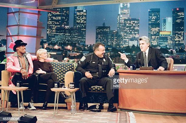 Basketball player Dennis Rodman comedian Ellen DeGeneres and police officer Vinnie Bazain during an interview with host Jay Leno on September 25 1997