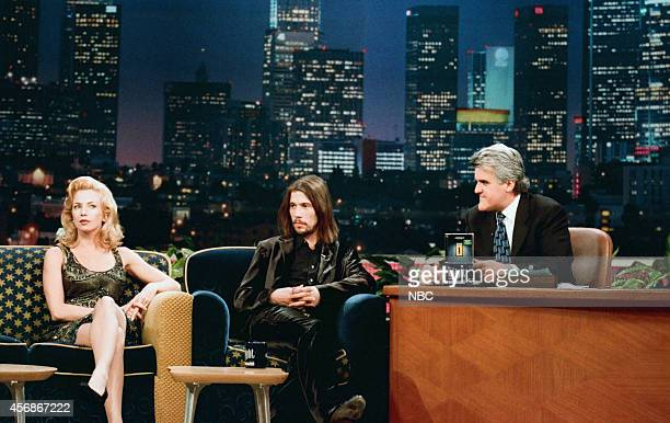 Actress Traci Lords and Jason Kay of the musical guest Jamiroquai during an interview with host Jay Leno on November 18 1997