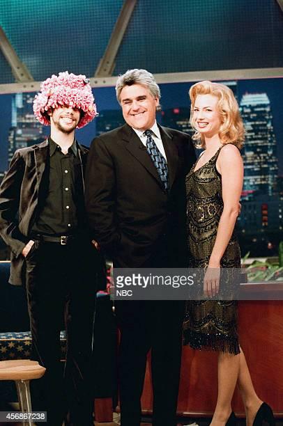 Singer Jason Kay host Jay Leno and actress Traci Lords on November 18 1997