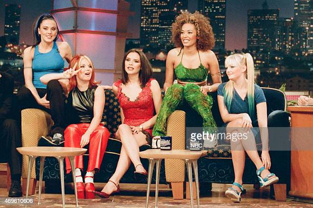 Melanie Chisholm Geri Halliwell Victoria Beckham Melanie Brown and Emma Bunton of the musical guest The Spice Girls during an interview with host Jay...