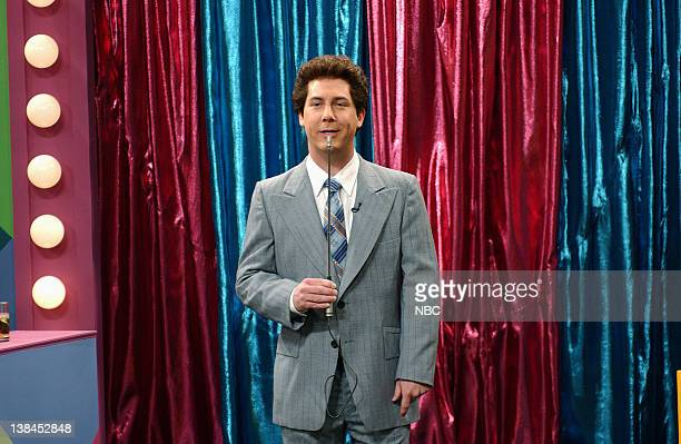 LIVE Episode 13 Air Date Pictured Chris Parnell as Bert Convy during Super Buzzers skit on March 2 2002