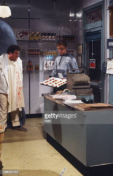 LIVE Episode 13 Air Date Pictured George Wendt as Mr Morrone Anthony Michael Hall as son during 'Morrone's Fish Market' sketch on March 22 1986