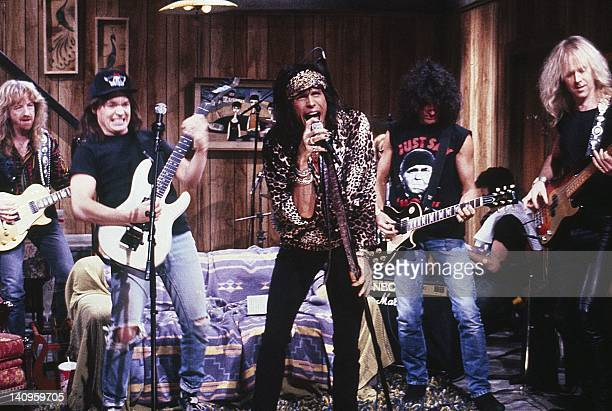 """Episode 13 -- Aired -- Pictured: Brad Whitford, Mike Myers as Wayne Campbell, Steven Tyler, Joe Perry, Brad Whitford during the """"Wayne's World"""" skit..."""
