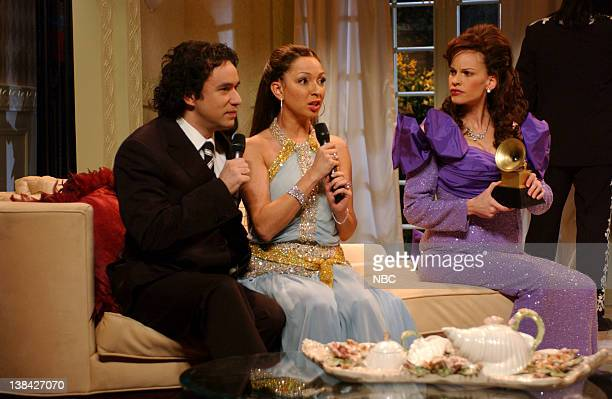 LIVE Episode 13 Aired Pictured Fred Armisen as Marc Anthony Maya Rudolph as Jennifer Lopez Hilary Swank as Loretta Lynn during After the Grammys skit