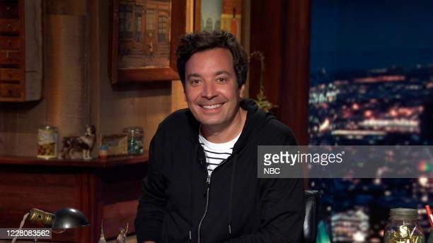 Episode 1306A -- Pictured in this screengrab: Host Jimmy Fallon arrives at his desk on August 12, 2020 --