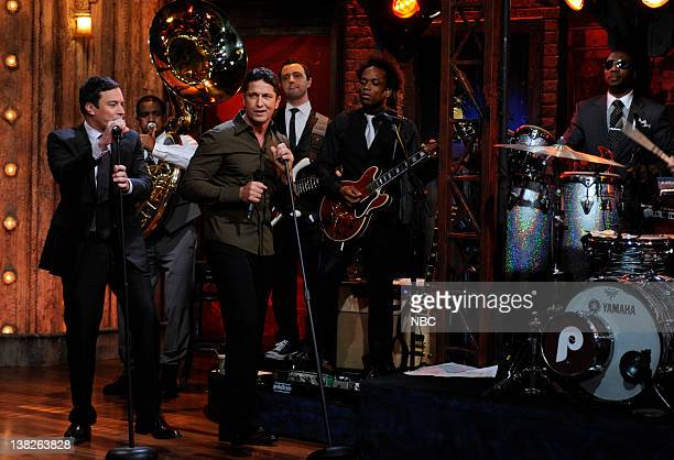 Episode 133 -- Airdate -- Pictured: Jimmy Fallon sings with Actor Gerard Butler on October 15, 2009