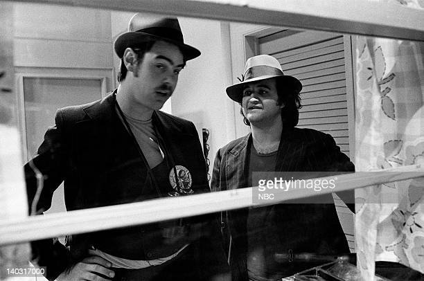 LIVE Episode 14 Air Date Pictured Dan Aykroyd as Eliot Ness John Belushi as Rico during The Untouchables skit on February 21 1976 Photo by NBCU Photo...