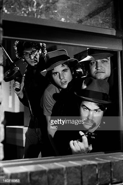 LIVE Episode 14 Air Date Pictured Tom Davis as Lee Desi Arnaz Jr as Youngblood Dan Aykroyd as Eliot Ness John Belushi as Rico during The Untouchables...