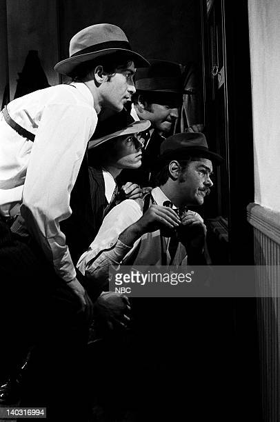 LIVE Episode 14 Air Date Pictured Unknown Desi Arnaz Jr as Youngblood John Belushi as Rico Dan Aykroyd as Eliot Ness during The Untouchables skit on...