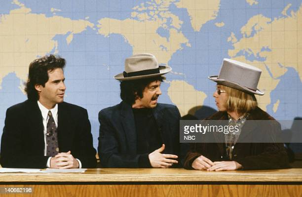 Dennis Miller Dana Carvey as Bob Dylan David Spade as Tom Petty during the 'Weekend Update' skit on February 23 1991 Photo by Raymond Bonar/NBCU...
