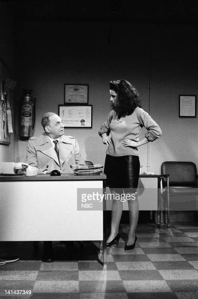 Edwin Newman and Julia LouisDreyfus as niece during the 'Hotline' skit on February 25 1984 Photo by Alan Singer/NBC/NBCU Photo Bank