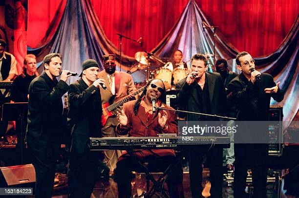 Musical guest Stevie Wonder performs with Jeff Timmons Drew Lachey Nick Lachey Justin Jeffre of 98 Degrees on June 19 1998