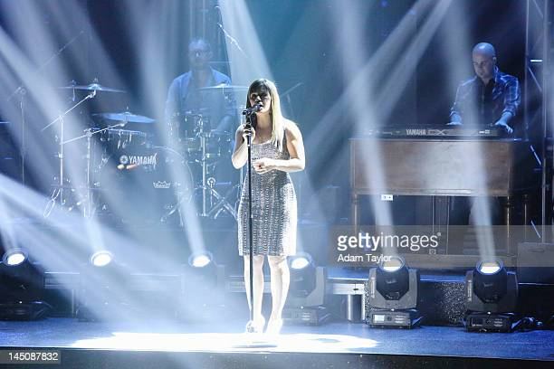 SHOW 'Episode 1410A' Grammy Awardwinning superstar Kelly Clarkson lit up the ballroom singing a medley of her hit songs 'Dark Side' and 'Stronger'...