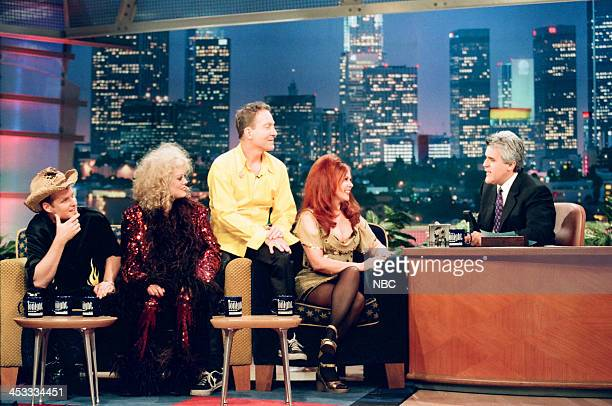 Keith Strickland Cindy Wilson Fred Schneider Kate Pierson of musical guest The B52's with host Jay Leno on August 6 1998