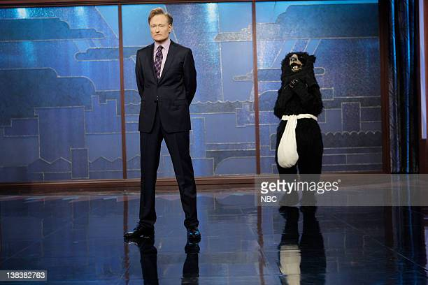 Host Conan O'Brien onstage with the Masturbating Bear on January 20 2010