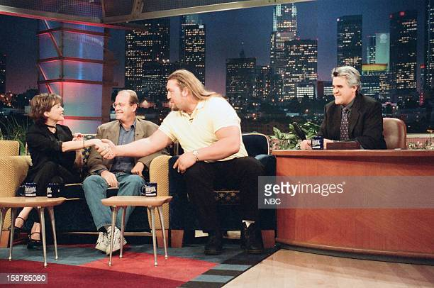 Actress Annette Bening actor Kelsey Grammer wrestler Paul'Giant' Wight during an interview with host Jay Leno on November 11 1998