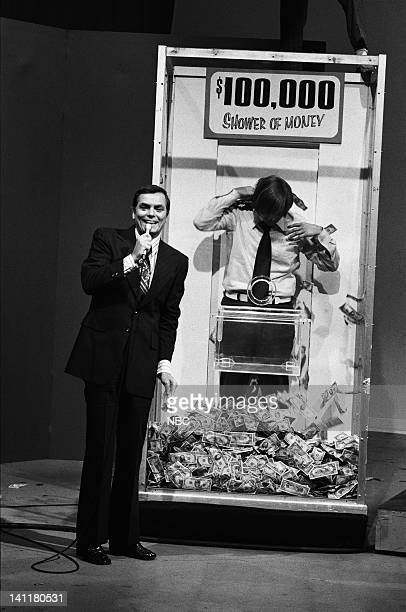 SQUARES Episode 15 Air Date Pictured Host Peter Marshall unknown contestant at The Shower of Money Photo by Frank Carroll/NBCU Photo Bank