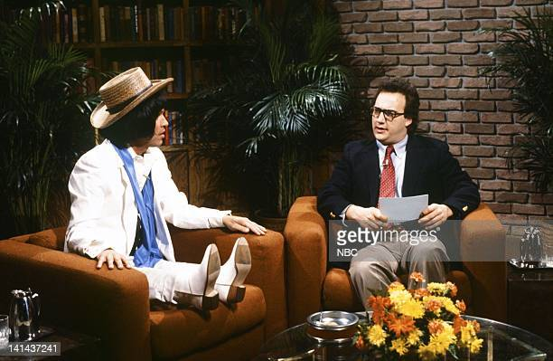 Episode 15 -- Pictured: Billy Crystal as Herve Villechaize and Jim Belushi as Fred Kaz during the 'Bad Career Moves' skit on March 17, 1984 -- Photo...