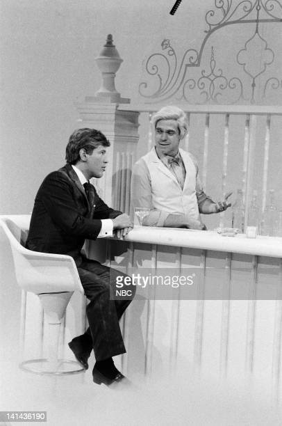 Billy Crystal as John F Kennedy and Joe Piscopo as St Peter during the 'God's Place' skit on March 17 1984 Photo by Alan Singer/NBC/NBCU Photo Bank