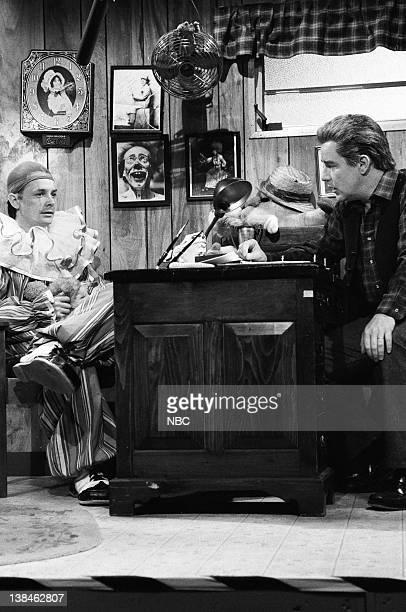 Michael J Fox as Jasper Phil Hartman as Mr Chapman during the 'Jasper The Stinging Clown' skit on March 16 1991