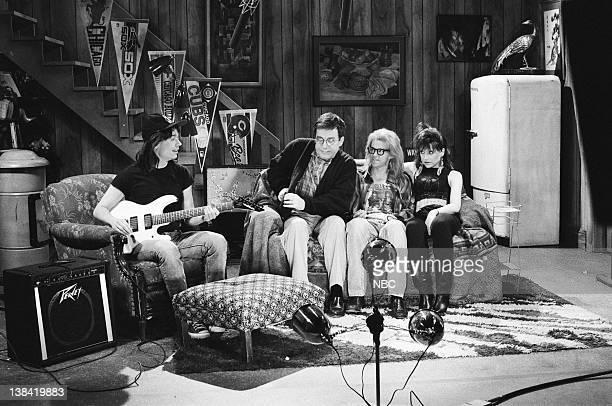 Mike Myers as Wayne Campbell Phil Hartman as Beev Algar Dana Carvey as Garth Algar Jan Hooks as Nancy Simmons during the 'Wayne's World' skit on...