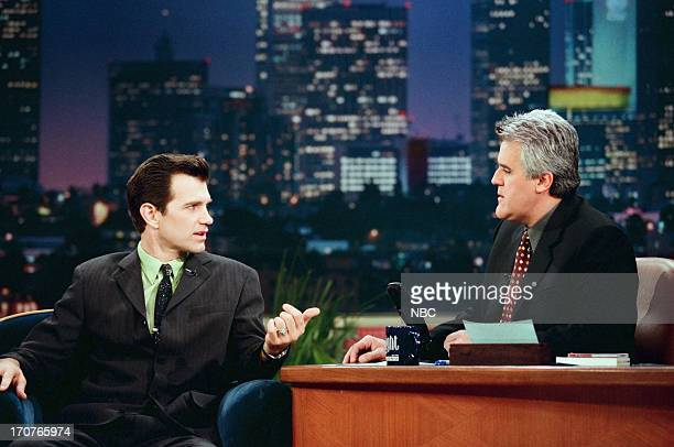 Musician Chris Isaak host Jay Leno during an interview on January 8 1999