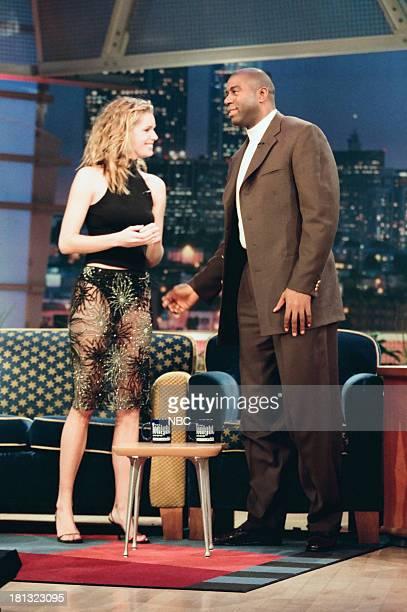 Model/actress Rebecca RomijnStamos basketball player Earvin Magic Johnson on February 12 1999