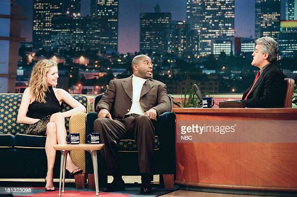 Model/actress Rebecca RomijnStamos basketball player Earvin Magic Johnson host Jay Leno during an interview on February 12 1999