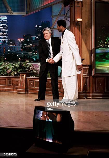 Host Jay Leno greets basketball player Kobe Bryant on April 8 1999