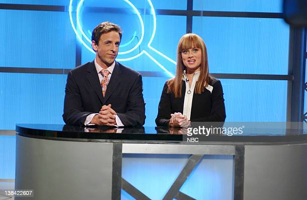 LIVE Episode 16 Aired Pictured Seth Meyers as Ian Gerrard Amy Poehler as Zoe Anderson during 'Spy Glass' skit