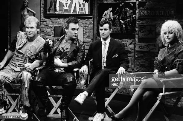 Brad Hall as Garage Band member Jim Belushi as Garage Band member Tim Kazurinsky as agent and Julia LouisDreyfus as Nina Blackwood during the 'MTV...