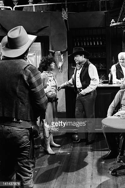 Debra Winger as Calamity Jane Phil Hartman as cowboy during the 'The Adventures Of Calamity Jane' skit on March 24 1990 Photo by Raymond...