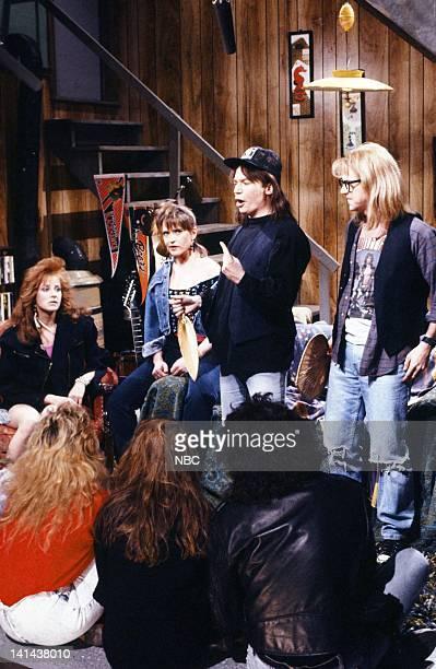 Debra Winger as Lisa Hartman Jan Hooks as Nancy Simmons Mike Myers as Wayne Campbell Dana Carvey as Garth Algar during the 'Wayne's World' skit on...