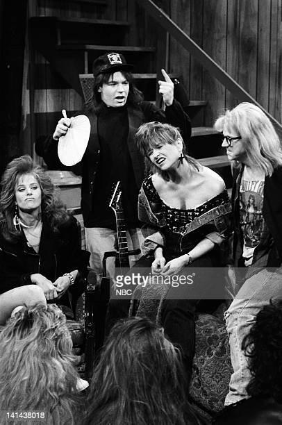 Debra Winger as Lisa Hartman Mike Myers as Wayne Campbell Jan Hooks as Nancy Simmons Dana Carvey as Garth Algar during the 'Wayne's World' skit on...