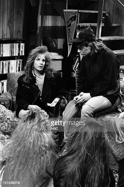 Debra Winger as Lisa Hartman Mike Myers as Wayne Campbell during the 'Wayne's World' skit on March 24 1990 Photo by Raymond Bonar/NBC/NBCU Photo Bank
