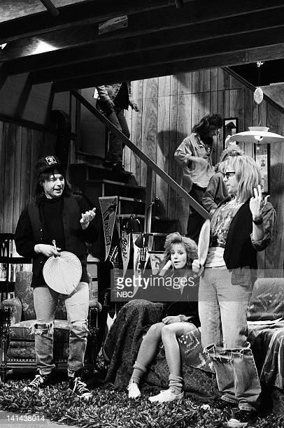 Mike Myers as Wayne Campbell Debra Winger as Lisa Hartman Dana Carvey as Garth Algar during the 'Wayne's World' skit on March 24 1990 Photo by...