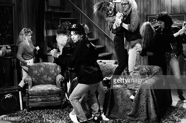 Mike Myers as Wayne Campbell Jan Hooks as Nancy Simmons Dana Carvey as Garth Algar during the 'Wayne's World' skit on March 24 1990 Photo by Raymond...