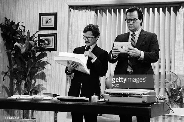 Episode 16 -- Pictured: Tim Kazurinsky as Mr. Price and Jim Belushi as Mr. Waterhouse during the 'Price Waterhouse' skit on April 7, 1984 -- Photo...