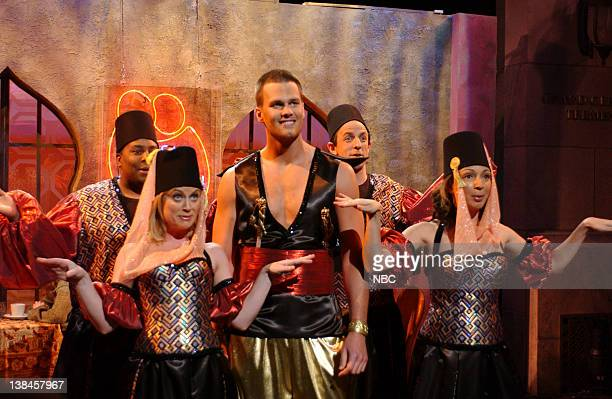 LIVE Episode 17 Aired Pictured Amy Poehler as singer Tom Brady Maya Rudolph as singer during Tom Brady's Falafel City skit