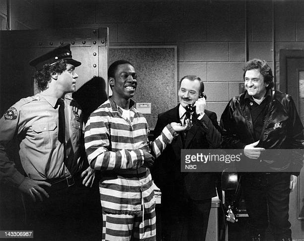 Joe Piscopo as guard Eddie Murphy as Frankie Brian DoyleMurray as warden Johnny Cash during the 'Last Request' skit on April 17 1982 Photo by