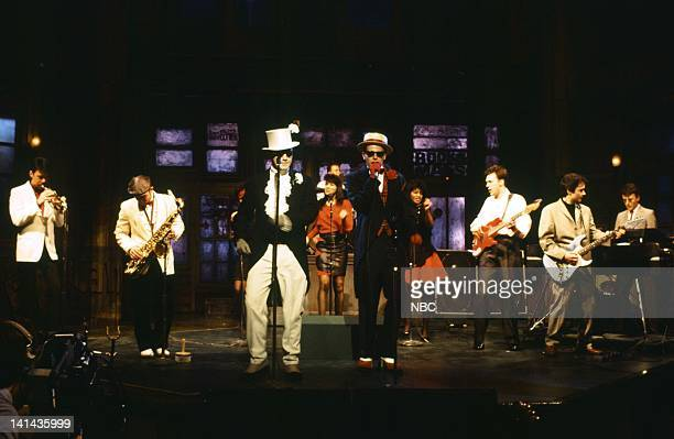 Lee Thompson Chas Smash Suggs Mark Bedford Chris Foreman Mike Barson of musical guest Madness performs on April 14 1984 Photo by Al Levine/NBC/NBCU...