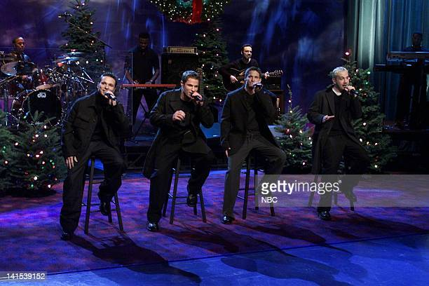 Drew Lachey Nick Lachey Jeffrey Timmons Justin Jeffre of musical guest 98 Degrees performs on November 29 1999 Photo by NBC/NBCU Photo Bank