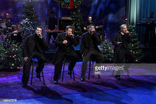 Drew Lachey Nick Lachey Jeffrey Timmons Justin Jeffre of musical guest 98 Degrees performs on November 29 1999