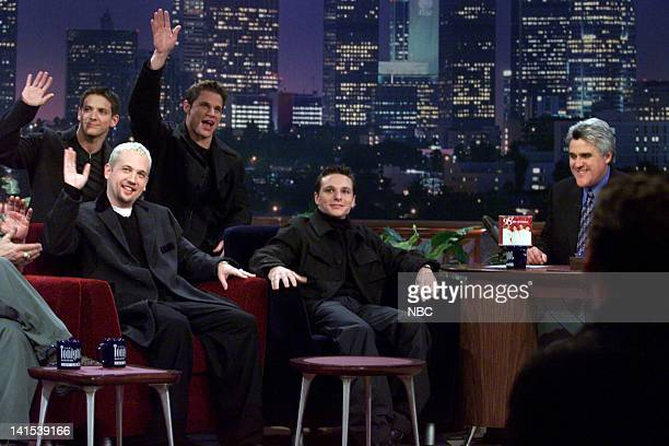 Jeff Timmons Justin Jeffre Nick Lachey Drew Lachey of musical guest 98 Degrees during an interview with host Jay Leno on November 29 1999 Photo by...
