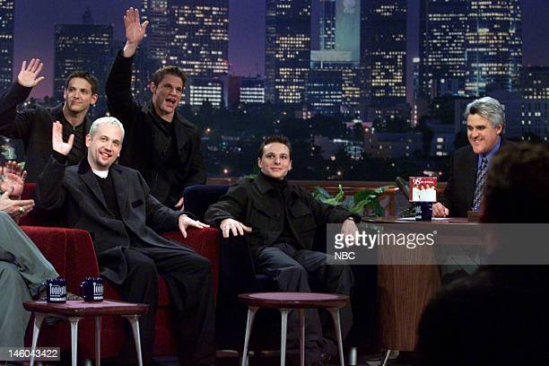 Jeff Timmons Justin Jeffre Nick Lachey Drew Lachey of musical guest 98 Degrees during an interview with host Jay Leno on November 29 1999