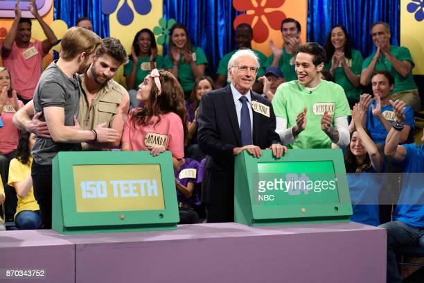 Episode 1729 -- Pictured: Leslie Jones as Marcia, Alex Moffat as Chris Hemsworth, Liam Hemsworth as himself, Miley Cyrus as Amanda, Larry David as...