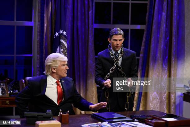 Alec Baldwin as President Donald J Trump Mikey Day as Michael Flynn during White House Cold Open in Studio 8H on Saturday December 2 2017