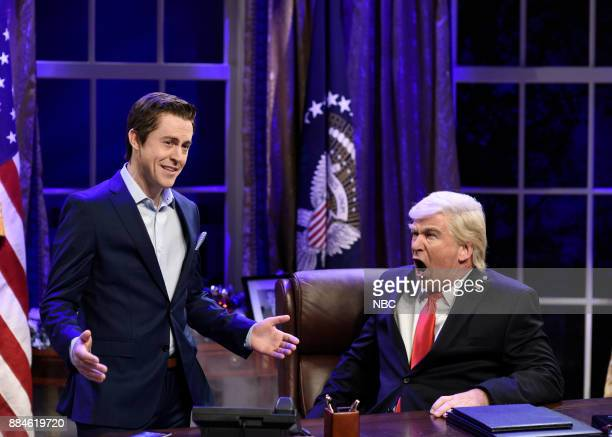 Alex Moffat as Billy Bush Alec Baldwin as President Donald J Trump during 'White House Cold Open' in Studio 8H on Saturday December 2 2017