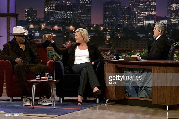 Basketball player Dennis Rodman and Actress Charlize Theron during an interview with host Jay Leno on January 3 2000